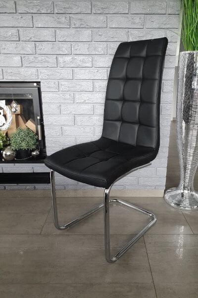 Nowoczesne czarne krzesła na płozach